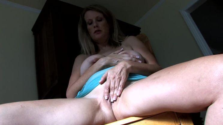 Kris squeezes those big tits
