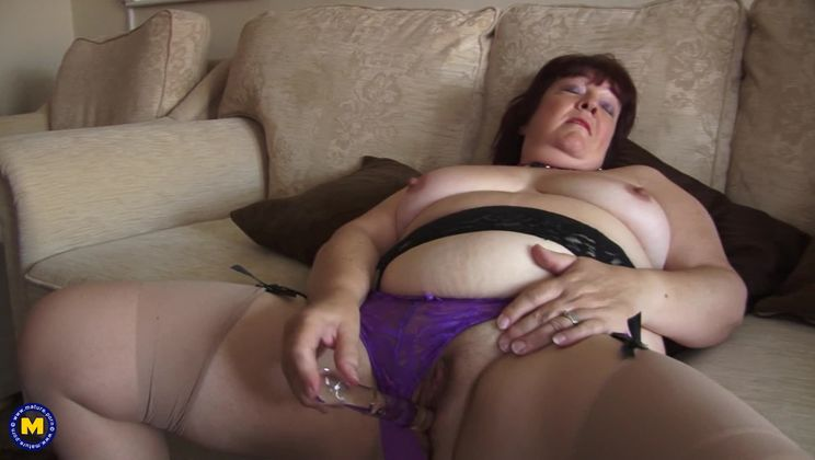 Naughty housewife getting herself wet