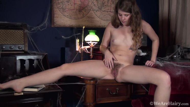 Jada is alone in her study and masturbates