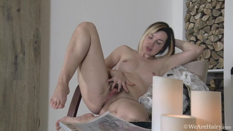 Sasha K strips naked by her candles to relax