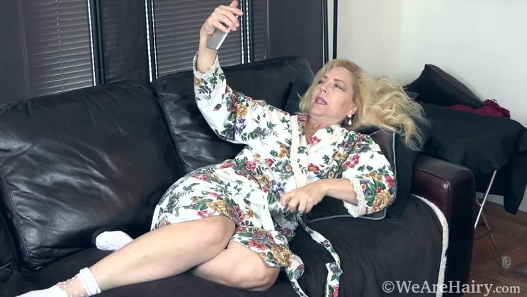 Badd Gramma strips naked on her black couch